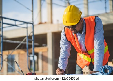 Asian engineer working in home construction area.
