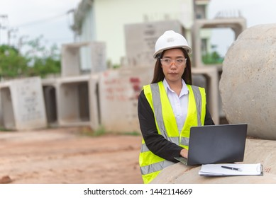 Asian engineer working at site of a large building project,Thailand people,Work overtime at construction site