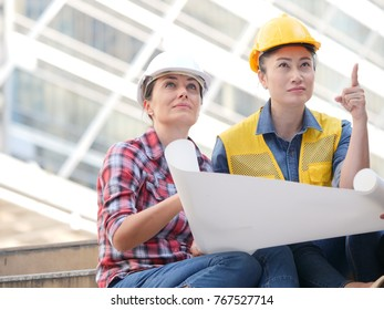 Asian engineers on site building working team work concept
