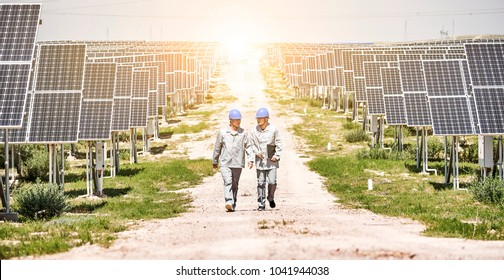 Asian engineers in the sky walk in the solar photovoltaic area