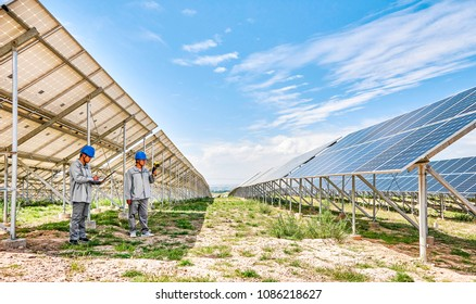 Asian engineers are using professional instruments to inspect photovoltaic panels