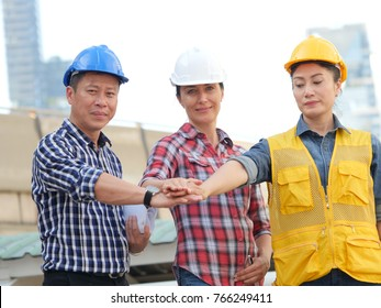Asian engineers working in team on site building