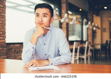 Asian Entrepreneur Thinking on Project in Cafe