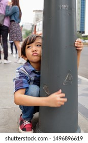 Asian Ethnic Child Whining and Cranky on Sidewalk Demanding for Something During Family Trip