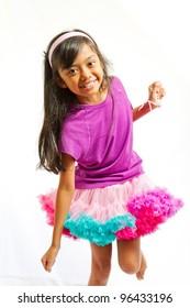 asian ethnic little girl happy dancing with tutu skirt