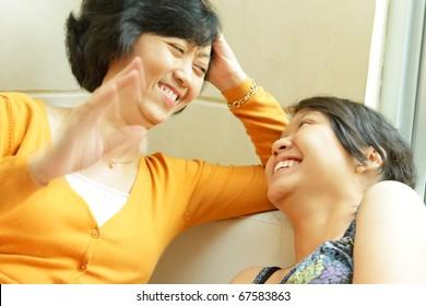 Asian ethnic mother enjoy having conversation with teenage daughter
