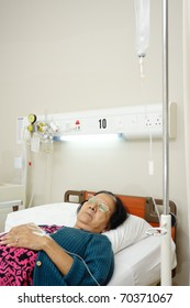 asian ethnic old patient woman bed rest in hospital ward