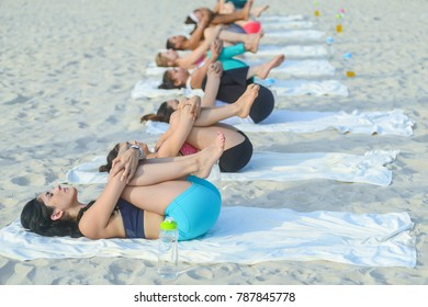 Asian and European women are practicing yoga on the beach. Koh Samui, Surat Thani, Thailand 7th June 2016