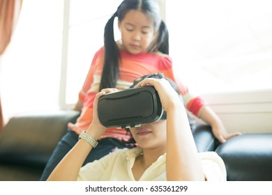 Asian family activity ,Mam uing VR for watch TV in live room.