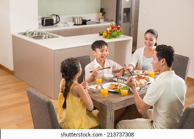 Asian family dining together in the kitchen