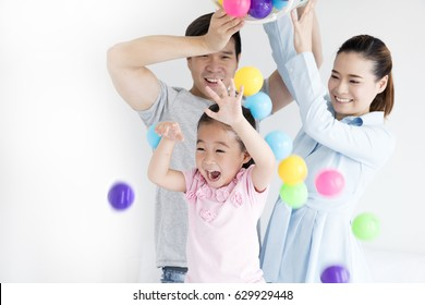 Asian Family, family enjoy playing ball together at home, mother father daughter