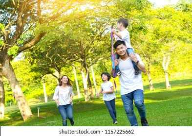 Asian family enjoyed outdoor activity in the park