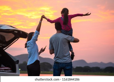 Asian Family Enjoying. happy little girl with family sitting in the car.Car insurance concept