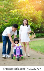 Asian family enjoying outdoor nature in the park