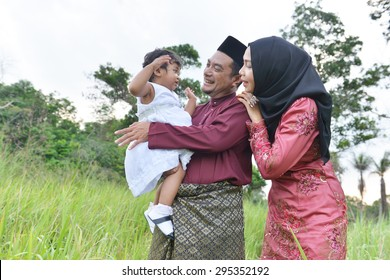 asian family enjoying quality time with father, mother and daughter