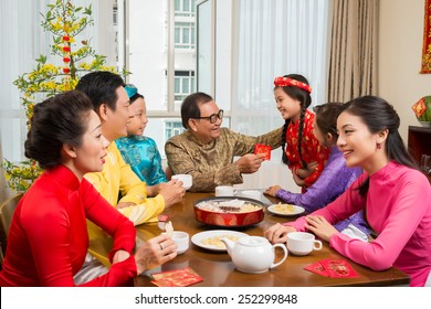 Asian family enjoying Tet celebration at home