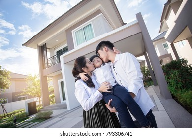 Asian family father, mother and cute baby girl Happy with Parents child over house background