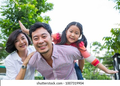 Asian family happiness together in the outside garden