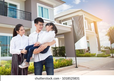 Asian family Happy with child over house background