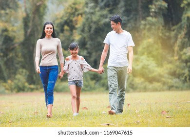 Asian family, Happy asian mother, father and daughter relax in the park