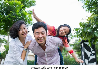Asian family happy portrait in garden.