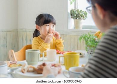 asian family having breakfast happily