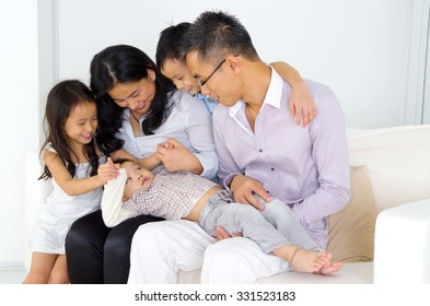 Asian family having fun at home