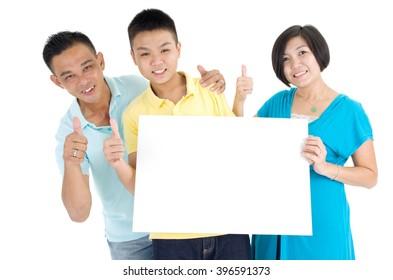 Asian family holding blank white board on white background.