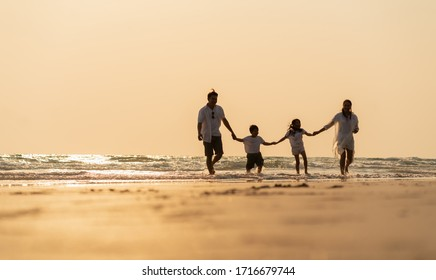 Asian family holidays at the beach. A happy family in asia Traveling, resting after the virus crisis, living life with family