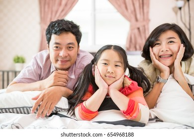 Asian family home do activity together on holiday.