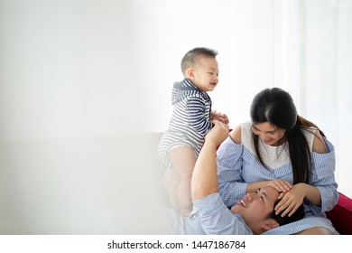 Asian family home happiness together their son.