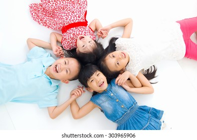 Asian family lying on the floor