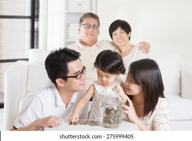Asian family money savings concept. Multi generations living lifestyle at home.