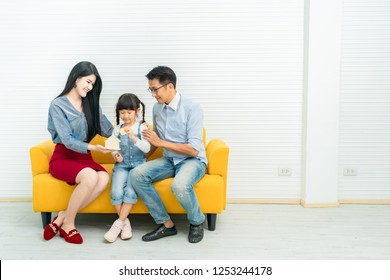 Asian family money savings concept.saving money to invest in a home or property in the future.