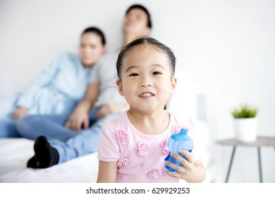 Asian Family, naughty little girl and parents