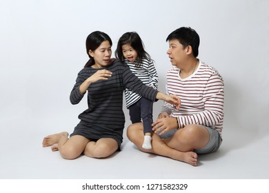 The Asian family on the white background.