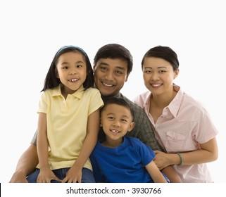 Asian family portrait against white background.