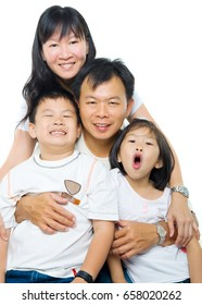 Asian family portrait, happy parents and children, isolated on white background.