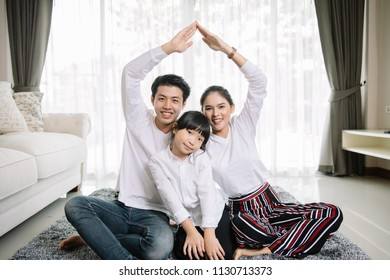 Asian family portrait with happy people smiling in Home ,Lifestyle and Holiday Concept.