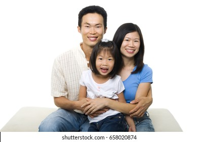 Asian family portrait on white background