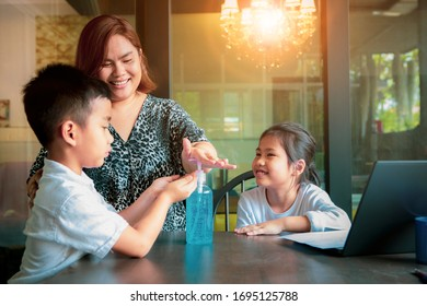 asian family practice children to hand cleaning by alcohol gel