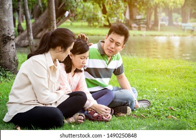 Asian family problem,parents talking sharing thoughts support her care,loving mother,father speak have comforting crying sad daughter,consoling hugging to child girl,understanding,consultation concept