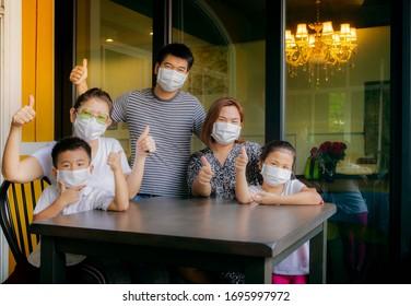 asian family quarantine at home while corona virus ,covid-19 infected period