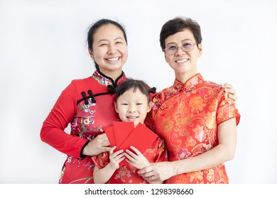 Asian family in red colour Chinese traditional dress holding red packet money at home,Happy Chinese New year