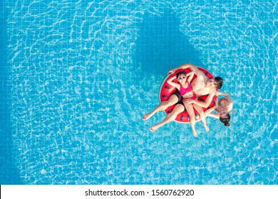 Asian family relax in swimming pool, this image can use for summer, father, moter, summer, water and sport concept