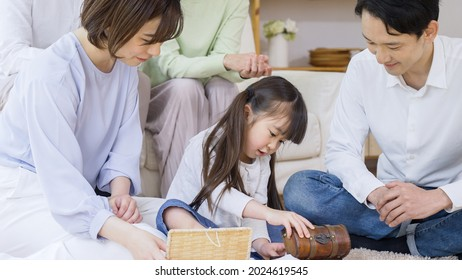 Asian family relaxing at home