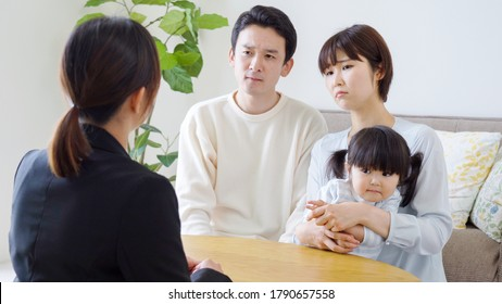 Asian family and salesman in the living room
