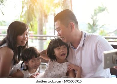 asian family selfie on outdoor