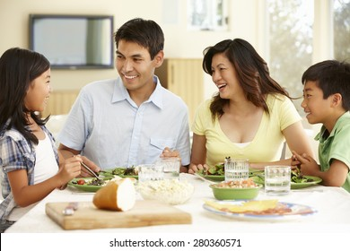 Asian family sharing meal at home