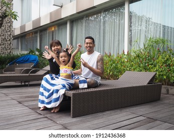 Asian family showing happy expression after swimming  - Shutterstock ID 1912436368
